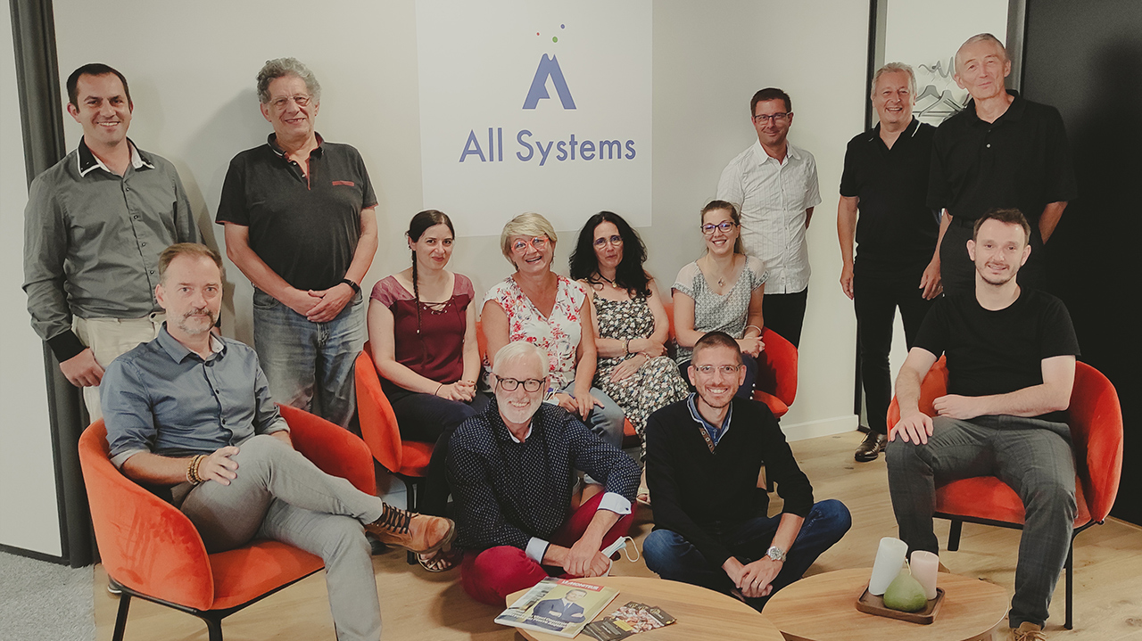 Collaborateurs en réunion a All Systems